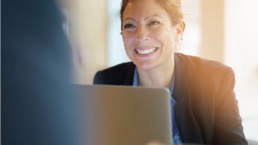 readiness wins smiling woman at computer