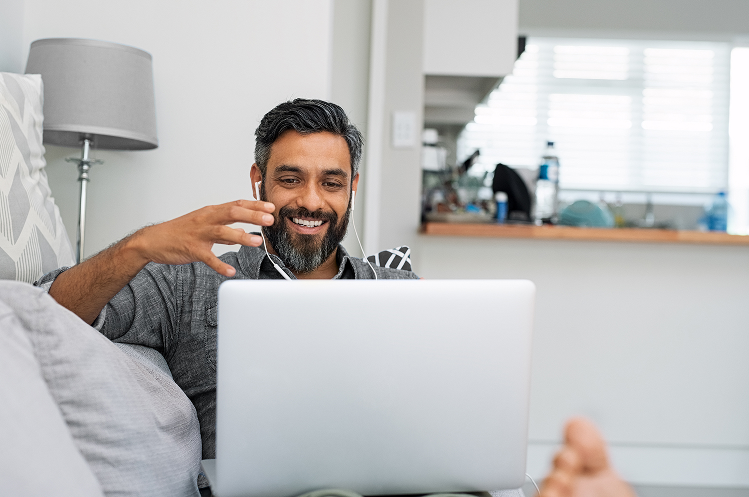 Man using laptop for video call; work from home