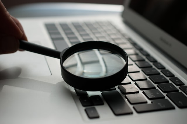 magnifying glass credit underwriting